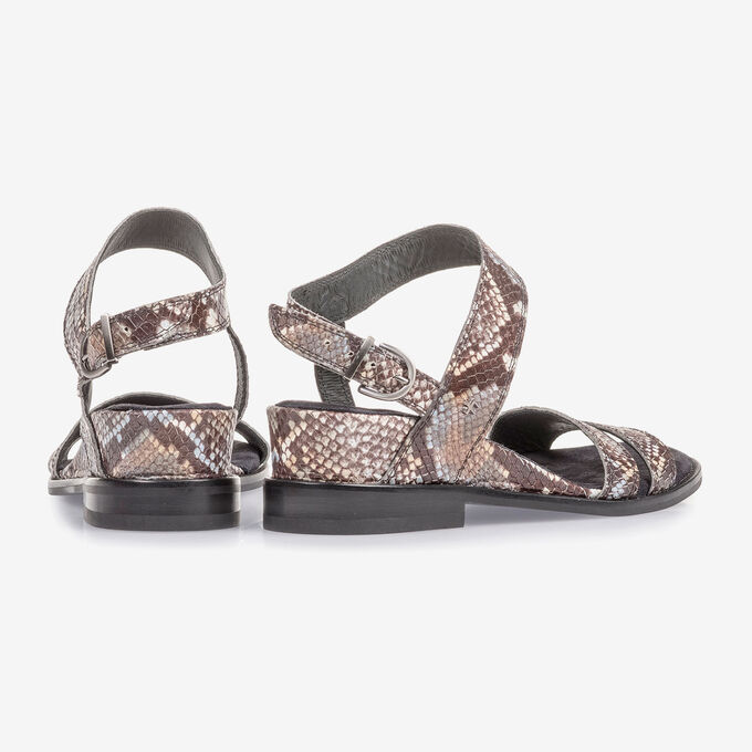 Brown and white leather sandals with snake print
