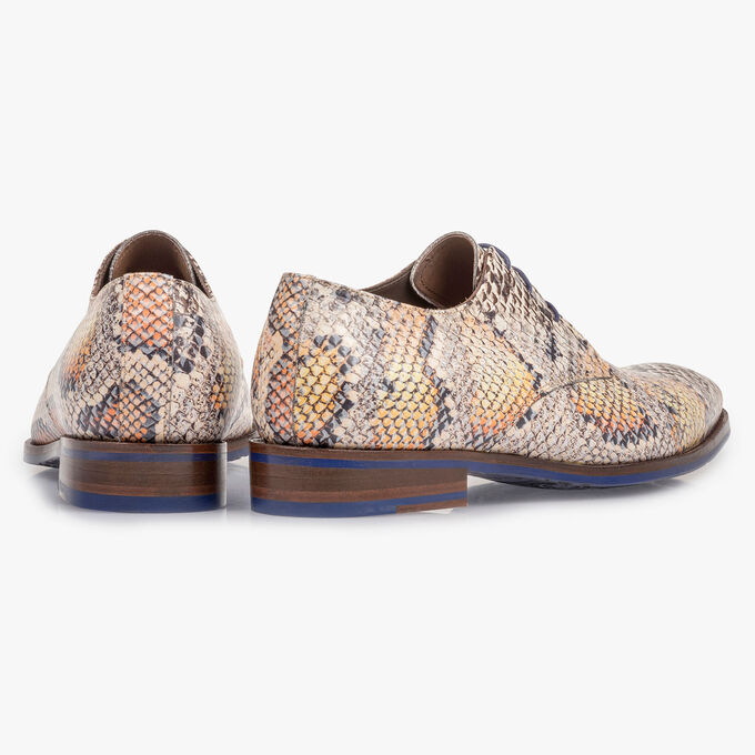 Premium lace shoe with an orange snake print