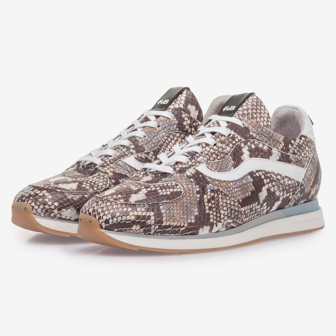 Brown and white sneaker with snake print