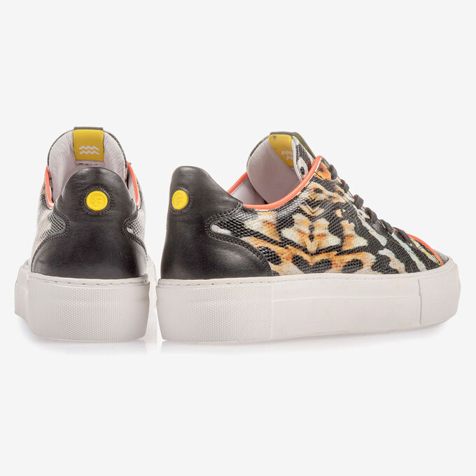 Black leather sneaker with an orange-coloured print