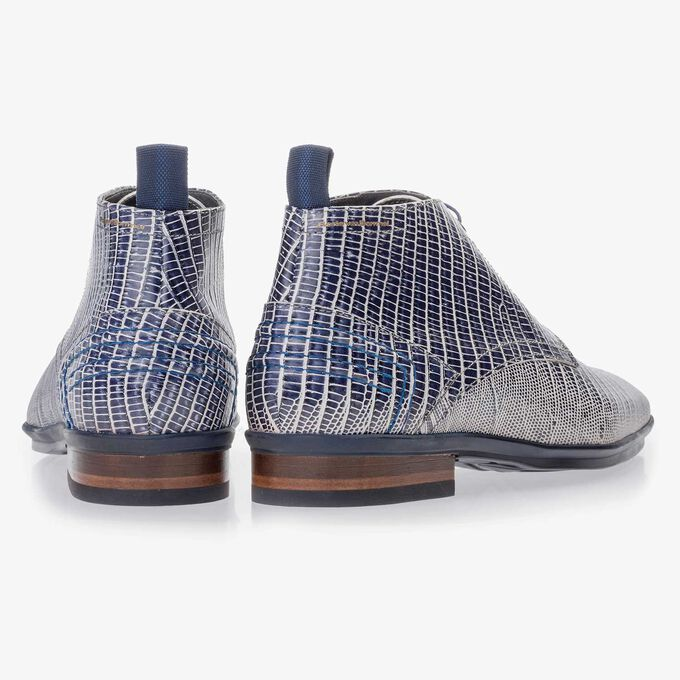 Blue leather lace boot finished with a lizard print
