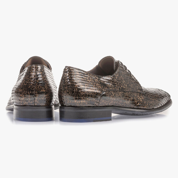 Brown patent leather lace shoe with metallic print